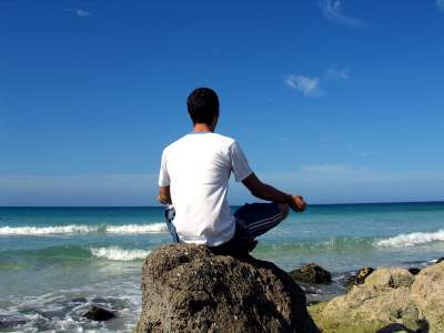 man meditating on law of attraction principles