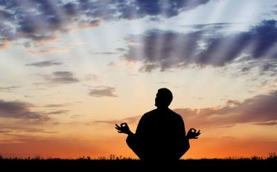 man meditating while suing Law of Attraction principles